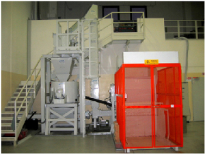 Deoiling system for aluminium chips complete with box dumper, collecting hopper, shredder and centrifuge.