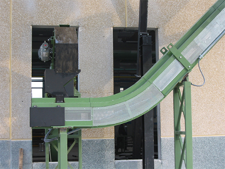 TVMSS drag conveyor outside that receives chips from a centralised plant and conducts it to the silo for storage.