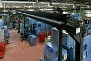 Overhead system of swarf evacuation from machining centres.