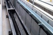 Screw manifold with open channel in a pit.