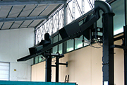 Manually operated dual discharge chute, rotating on a fixed pivot, with air cylinder and end-appendage adjustable by air cylinder.